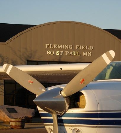 Image of Airplane in front of Fleming Field Airport Building